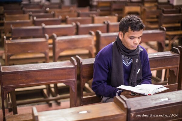 India, February 2017 			A seminarian reading the Gospel at the Chapel of the Seminary in Jharkhand State.